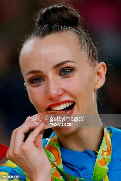 Bronze medallist Ukraine's Ganna Rizatdinova poses with her medal on the podium of the individual allaround final event of the Rhythmic Gymnastics at...