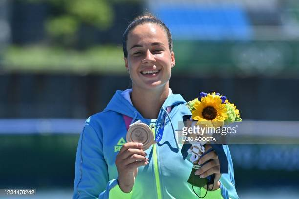 Bronze medallist Ukraine's Luidmyla Luzan poses on the podium following the women's canoe single 200m final during the Tokyo 2020 Olympic Games at...