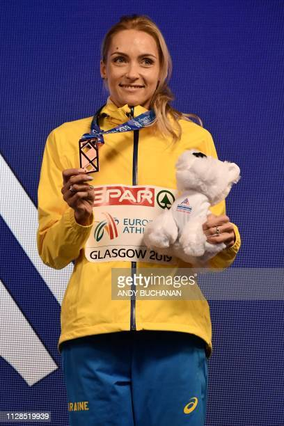 Bronze medallist Ukraine's Olha Saladukha poses with her medal during the medal presentation ceremony for the womens triple jump final at the 2019...