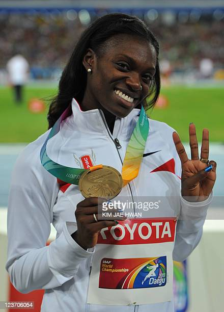 Bronze medallist US athlete Dawn Harper poses during the award ceremony for the women's 100 metre hurdles at the International Association of...