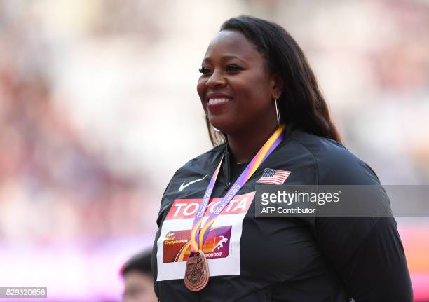 Bronze medallist US athlete Michelle Carter poses on the podium during the victory ceremony for the women's shot put athletics event at the 2017 IAAF...