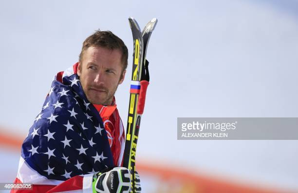 Bronze medallist US skier Bode Miller arrives on the podium during the Men's Alpine Skiing SuperG Flower Ceremony at the Rosa Khutor Alpine Center...