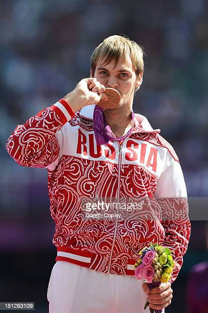 Bronze medallist Vladimir Sviridov of Russia poses on the podium during the medal ceremony for the Men's Long Jump F36 final on day 7 of the London...