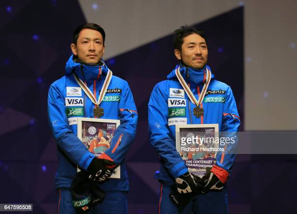 Bronze medallists Akito Watabe and Yoshito Watabe of Japan celebrate during the medal ceremony after the Men's Nordic Combined HS130 Ski Jumping / 2...