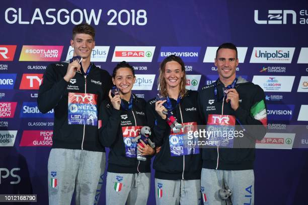 Bronze medallists Alessandro Miressi Elena Di Liddo Italy's Margherita Panziera and Fabio Scozzoli pose on the podium during the medal ceremony for...