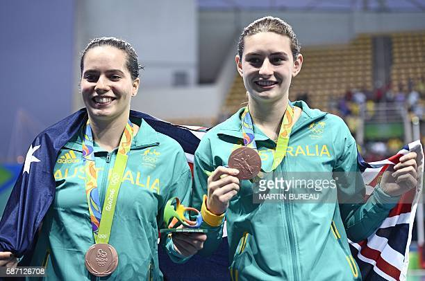Bronze medallists Australia's Maddison Keeney and Australia's Anabelle Smith pose during the podium ceremony of the Women's Synchronized 3m...