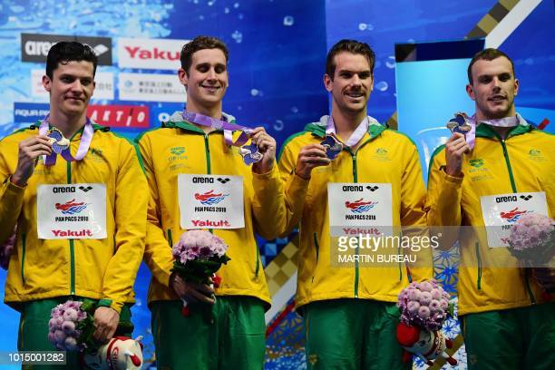 Bronze medallists Australia's swimmers Jack Cartwright Alexander Graham James Roberts and Kyle Chalmers pose on the podium of the 400m Free Relay men...