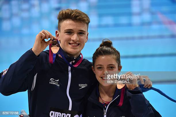 Bronze medallists Britain's Georgia Ward and Matthew Lee pose after the final of the team diving event on Day 1 of the European aquatics...