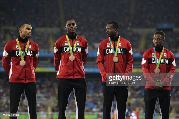 Bronze medallists Canada's Akeem Haynes Aaron Brown Brendon Rodney and Andre De Grasse stand on the podium during the medal ceremony for the Men's...