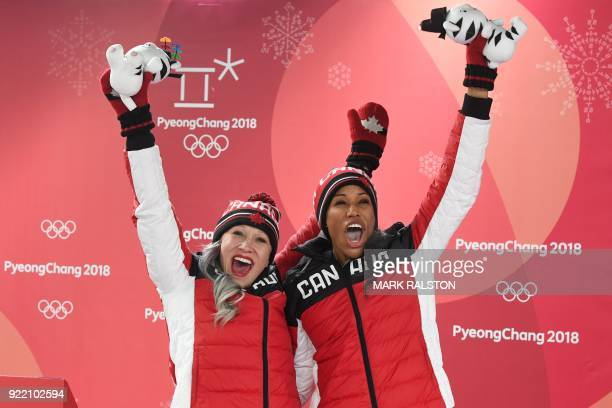 TOPSHOT Bronze medallists Canada's Kaillie Humphries and Canada's Phylicia George celebrate on the podium during the victory ceremony after the...