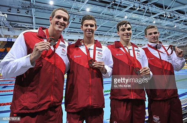 Bronze medallists England's Adam Brown James DisneyMay Adam Barrett and Benjamin Proud poses during the Men's 4x100m Freestyle relay medal ceremony...