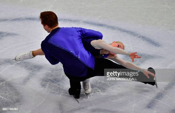 Bronze medallists Evgenia Tarasova and Vladimir Morozov of Russia compete in the pairs free skating event at the ISU World Figure Skating...