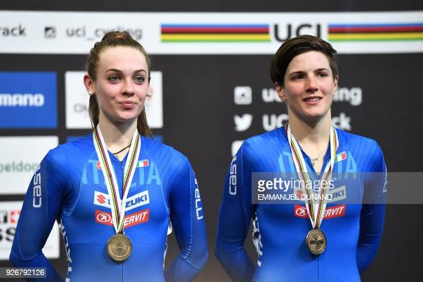 Bronze medallists Italy's Letizia Paternoster and Maria Giulia Confalonieri pose on the podium after taking part in the women's madison final during...