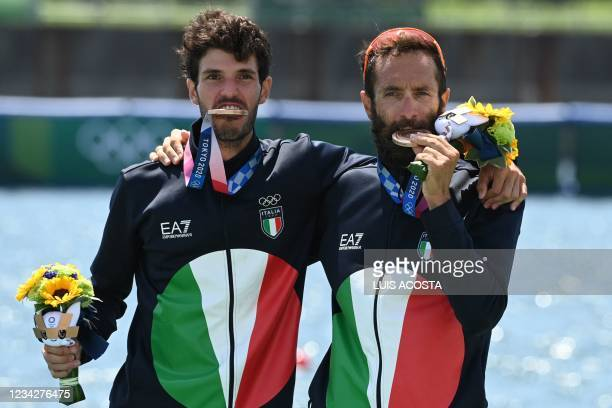 Bronze medallists Italy's Stefano Oppo and Pietro Ruta pose on the podium following the lightweight men's double sculls final during the Tokyo 2020...