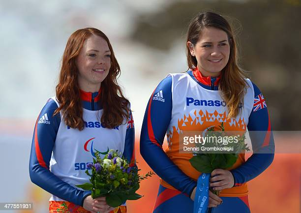 Bronze medallists Jade Etherington of Great Britain and guide Caroline Powell during the flower ceremony for the Women's Super-G - Visually Impaired...
