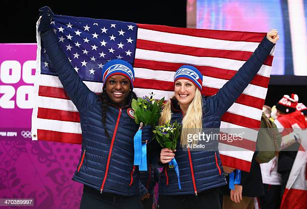 Bronze medallists Jamie Greubel and Aja Evans of the United States team 2 pose during the flower ceremony during the Women's Bobsleigh on Day 12 of...
