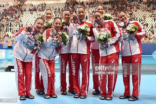 Bronze medallists Japan celebrate during the medal ceremony for the Women's Team Technical Synchronised Swimming Final on day three of the 16th FINA...