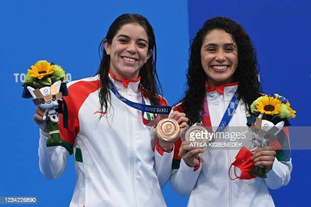 Bronze medallists Mexico's Alejandra Orozco Loza and Mexico's Gabriela Agundez Garcia pose on the podium after the women's synchronised 10m platform...