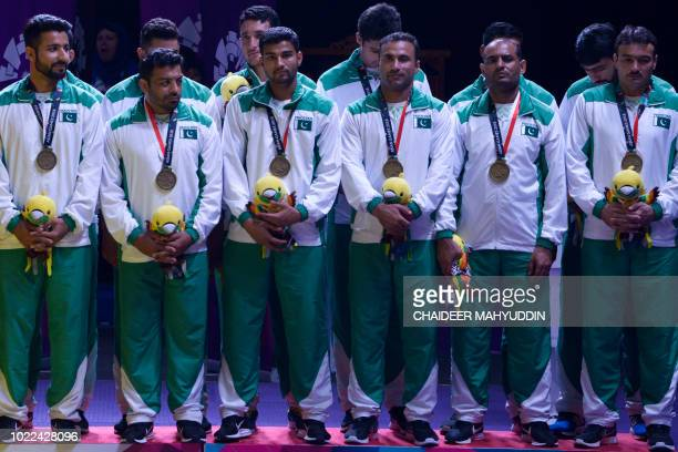 Bronze medallists Pakistan celebrate during the victory ceremony of the men's team kabaddi event at the 2018 Asian Games in Jakarta on August 24 2018