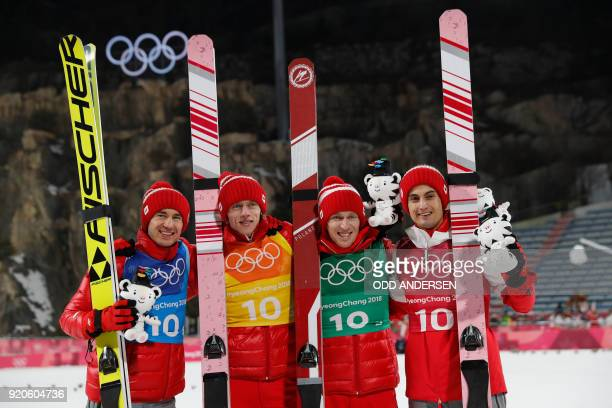 Bronze medallists Poland's Kamil Stoch Dawid Kubacki Dawid Kubacki and Maciej Kot celebrate during the victory ceremony in the men's large hill team...