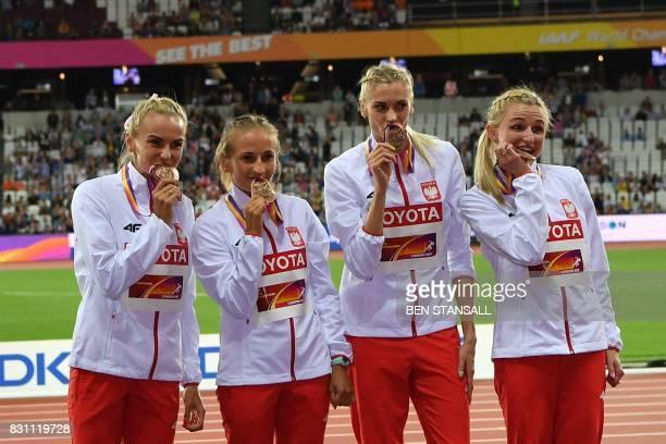 Bronze medallists Poland's Malgorzata Holub Poland's Iga Baumgart Poland's Aleksandra Gaworska and Poland's Justyna Swiety pose on the podium during...