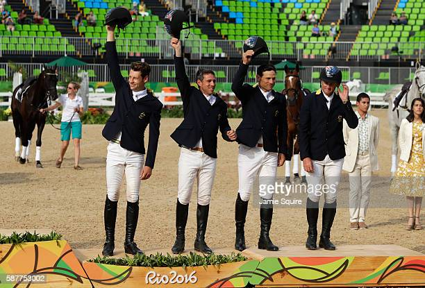 Bronze medallist's Shane Rose Stuart Tinney Sam Griffiths and Christopher Burton of Australia pose during the medal ceremony for the eventing team...