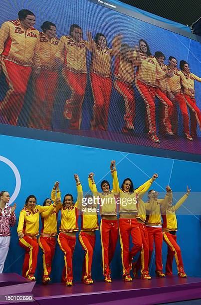 Bronze medallists Spain celebrate on the podium during the medal ceremony for the Women's Teams Synchronised Swimming Free Routine final on Day 14 of...