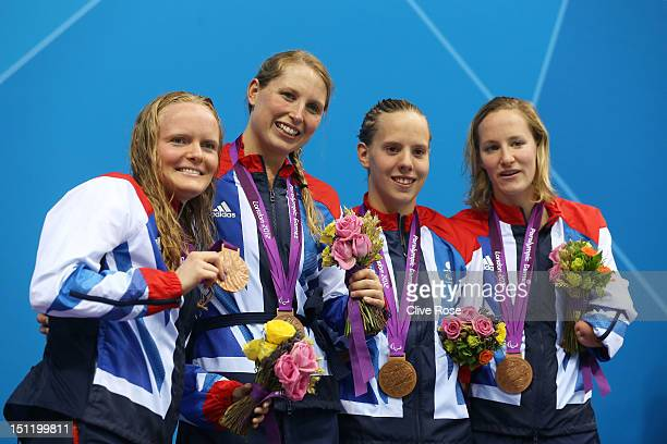 Bronze medallists Susannah Rodgers Stephanie Millward Louise Watkin and Claire Cashmore of Great Britain pose on the podium during the medal ceremony...