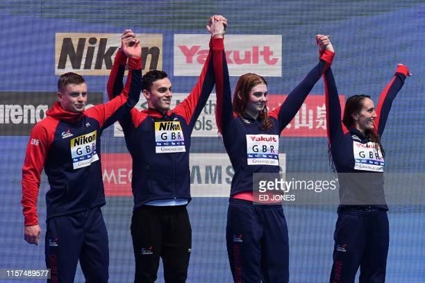 Bronze medallists team Great Britain Britain's Adam Peaty Britain's Georgia Davies Britain's James Guy and Britain's Freya Anderson celebrate on the...