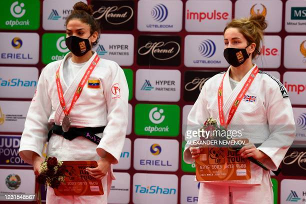 Bronze medallists Venezuela's Anriquelis Barrios and Britain's Amy Livesey pose on the podium of the women's -63kg category combat at the Tashkent...