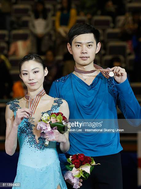 Bronze medallists Xiaoyu Yu and Yang Jin of China stand on the podium of Pair Champion on day three of the ISU Four Continents Figure Skating...