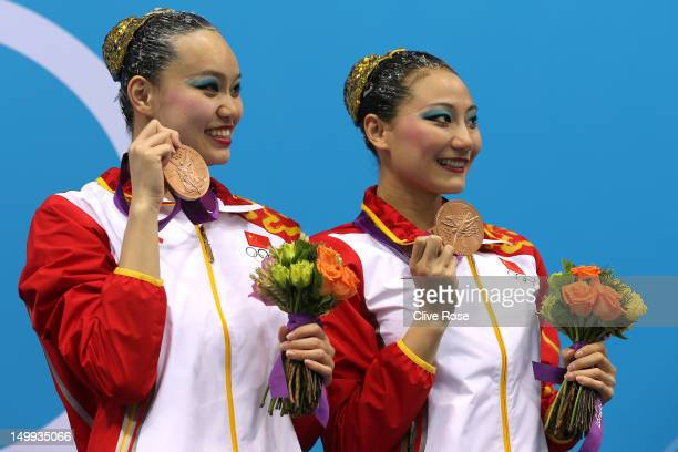 Bronze medallists Xuechen Huang and Ou Liu of China pose on the podium during the medal ceremony for the Women's Duets Synchronised Swimming Free...