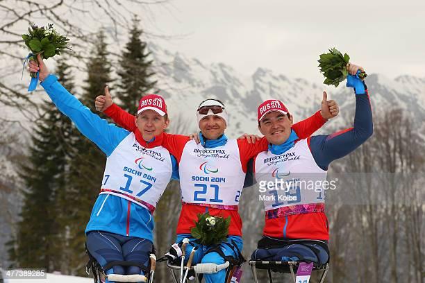 Bronze melalist Aleksandr Davidovich of Russia gold medalist Roman Petushkov of Russia and silver medalist Irek Zaripov of Russia pose at the flower...
