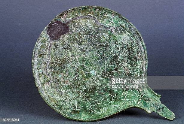 Bronze mirror with male figures Italy Etruscan civilisation half 4th century or early 3rd century BC Grosseto Museo Archeologico E D'Arte Della...