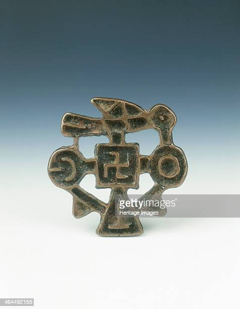 Bronze 'Nestorian Cross' China probably 1st millenium AD A socalled Nestorian cross with a swastika design in the middle and a bird to one side
