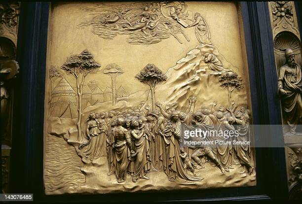 Bronze panel doors on the Baptistery of San Giovanni by Lorenzo Ghiberti Florence Italy This scene is a depiction of Moses Receiving the Tablets of...