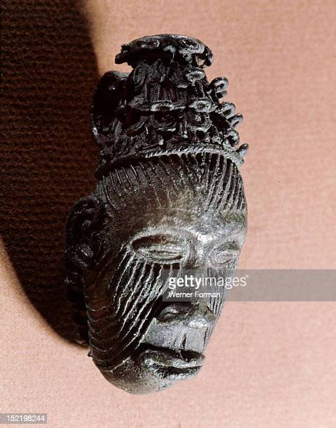 Bronze pendant in the form of a head Until recently similar designs were used by Igbo titled men for scarifications known as Ichi Nigeria Igbo Ukwu...