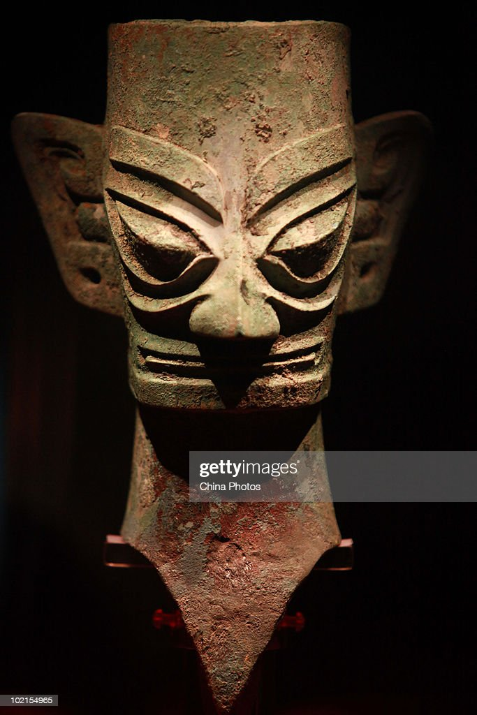 A bronze portrait is displayed at the Sanxingdui Museum on June 14, 2010 in Guanghan of Sichuan Province, China. Sanxingdui Museum is located in Northeast of Sanxingdu archeological site which believed to be the capital of ancient Shu, with more than 3,000-year history.