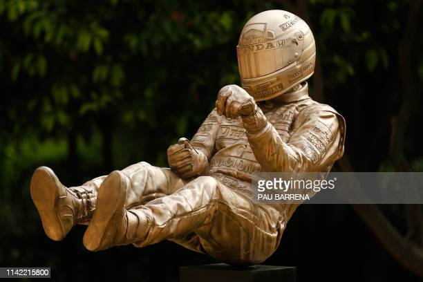 A bronze sculpture by British artist Paul Oz depicting late Brazilian Formula One driver Ayrton Senna is unveiled during a ceremony in Barcelona on...