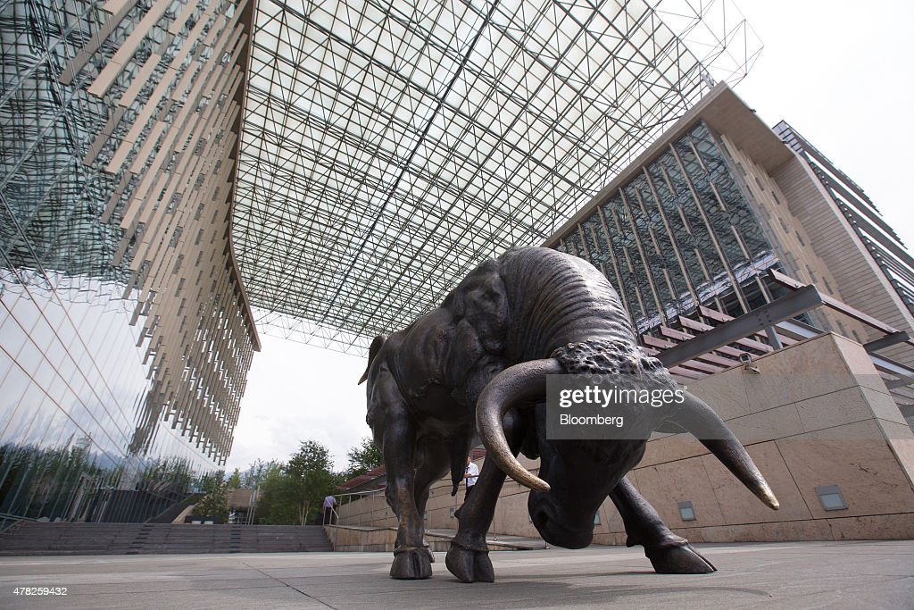 A bronze sculpture of a charging bull stands at the entrance to the financial center in the central business district in Almaty, Kazakhstan, on Tuesday, June 23, 2015. Kazakhstan completed its negotiations to become the 162nd member of the World Trade Organization, after 19 years of negotiations, and hopes to fully ratify its accession by Oct. 31. Photographer: Andrey Rudakov/Bloomberg via Getty Images