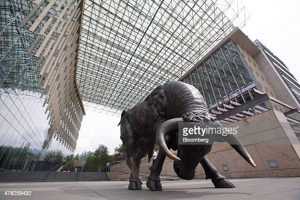 A bronze sculpture of a charging bull stands at the entrance to the financial center in the central business district in Almaty Kazakhstan on Tuesday...
