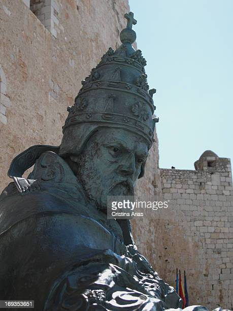 Bronze sculpture of Pope Benedict XIII Pope Luna situated on the rocks on which stands the castle of Peniscola and built in the late twentieth...