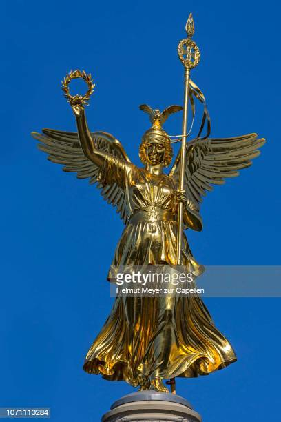 Bronze sculpture of Victoria on the Victory Column, inaugurated in 1873, blue sky, Berlin, Germany