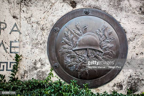 bronze shield on the wall of the tomb of the unknown solider, parliament of greece - greek parliament stock pictures, royalty-free photos & images