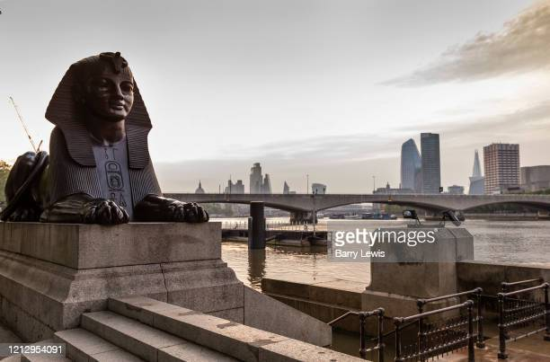 Bronze Sphynx guarding Cleopatras Needle, made in Egypt for the Pharaoh Thotmes III in 1460 BC and brought to London from Alexandria in 1878...