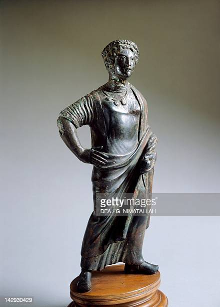 Bronze statue depicting a deity or female figure making an offering. Etruscan Civilization, 400-375 BC. Florence, Museo Archeologico Nazionale