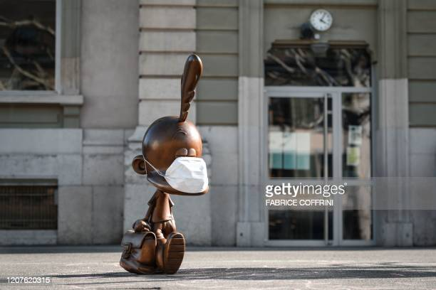 A bronze statue depicting cartoon character Titeuf the 8yearold boy with a blonde cowlick created by Swiss cartoonist Zep and wearing a protective...