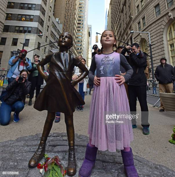 A bronze statue entitled Fearless Girl by sculptor Kristen Visbal was officially unveiled in Lower Manhattan placed opposite the iconic Wall Street...