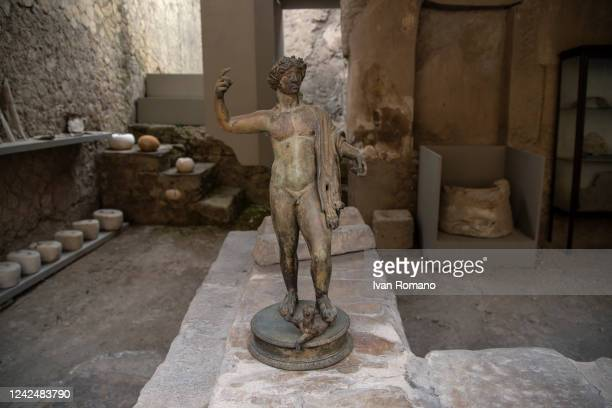 Bronze statue inside a deposit in the ancient Roman city of Herculaneum destroyed in 79 AD by the eruption of Vesuvius which also affected Pompeii,...