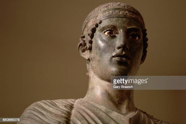 A bronze statue of a charioteer from approximately 470 BC Delphi Greece | Detail of 'The Charioteer of Delphi'